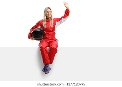 Female racer sitting on a panel and waving isolated on white background