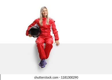 Female racer in a suit sitting on a panel isolated on white background