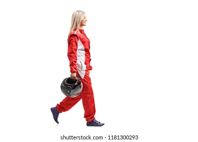 Female racer walking and holding a helmet isolated on white background