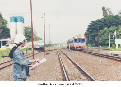 Female  Railroad engineers  are inspecting the railway or track