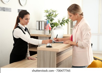 Female receptionist and woman in hotel