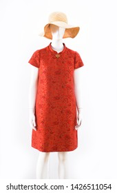 female red floral pattern sundress with straw hat on mannequin isolated-white background