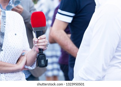 Female reporter making press or media interview
