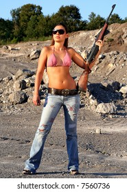 Female with rifle in wilderness