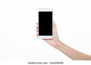 Female right hand holding smartphone with blank screen on white background