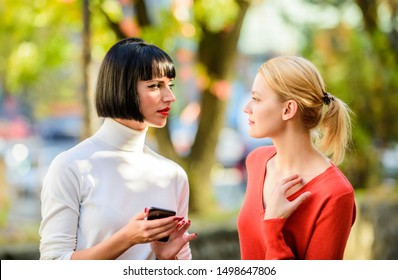 Female rivalry. Friendship problems rivalry and jealousy. Pretty girls friends sisters. Eye contact. Women looking at each other with attention. Rivalry and leadership. Blonde brunette competitors.