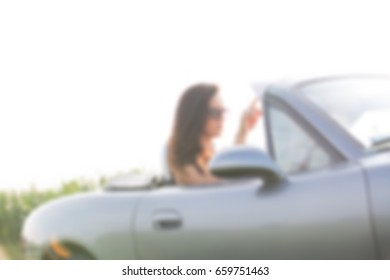 Female Road Trip Concept blurred background