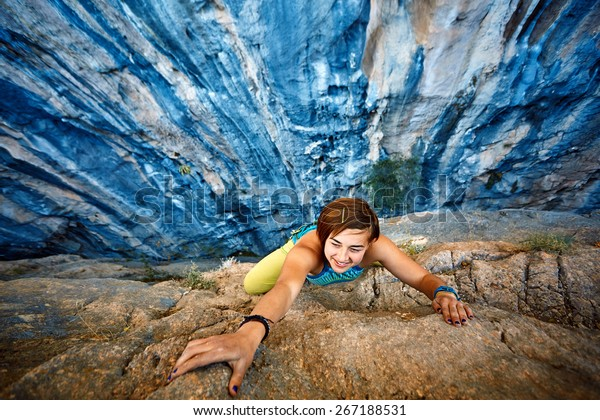 Female Rock Climber On The Cliff Stock Image - Image of