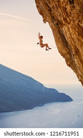 Female rock climber falling of cliff while lead climbing