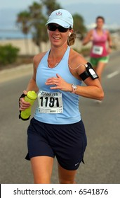female runner competing in 10K race