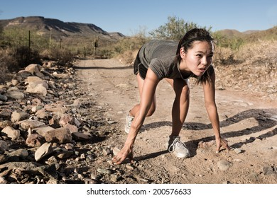 Female Runner Set to Race on a Desert Trail