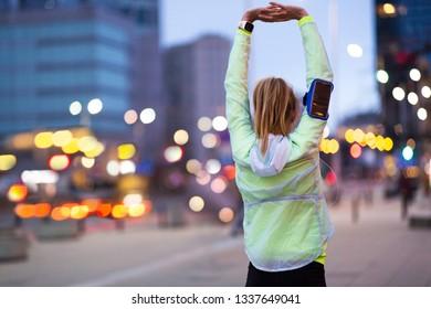 Female runner stretching before jog