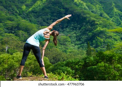 Female runner stretching outdoors.