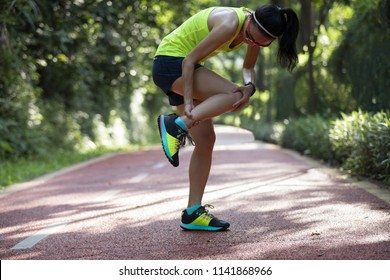 Female runner suffering with pain on sports running injury