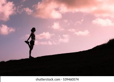 Female runner warming up before run