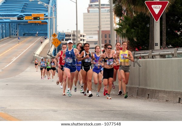 Female runners in the 2006 Gate River Run coming over the Main Street Bridge  in Jacksonville, FL (March 11, 2006)
