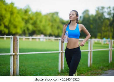 Female running athlete. Woman runner sprinting for healthy lifestyle