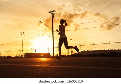 Female running in the city.