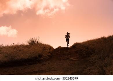 Female running cross country.