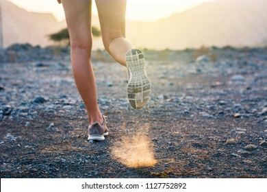 Female running in the desert low angle view