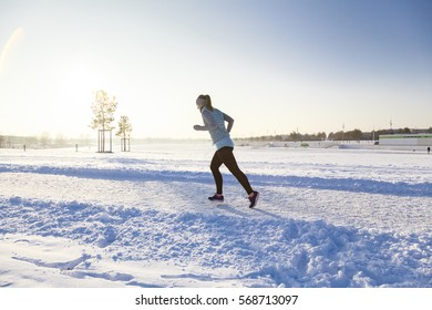 Female runs from right to left in winter landscape portrait mode