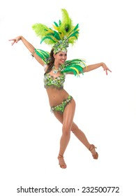 Female samba dancer wearing colorful costume over white background