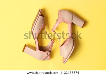 c444f91e3 Female Sandals On Heel On Colored Stock Photo (Edit Now) 1133133374 ...