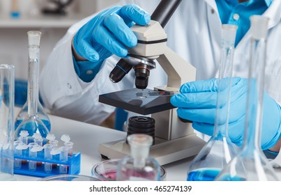 Female Scientist Analyzing Sample In Laboratory.laboratory assistant analyzing a sample