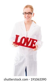 """Female scientist holding a red """"Love"""" text"""