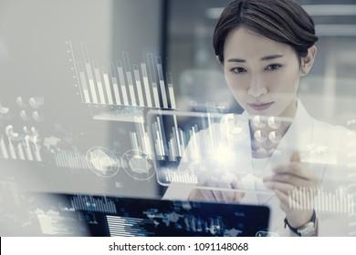 Female scientist looking futuristic GUI.
