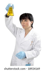 A female scientist observing a chemical in a laboratory  flask.