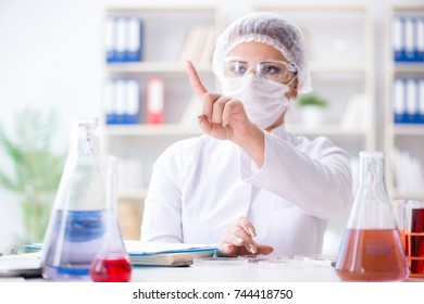 Female scientist researcher conducting an experiment in a labora