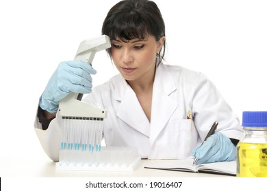 A female scientist running lab tests and documents laboratory test results