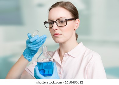 female scientist with a test tube in a laboratory