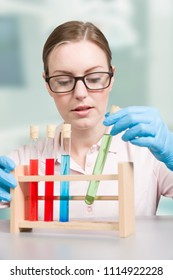 female scientist working with test tubes in a laboratory