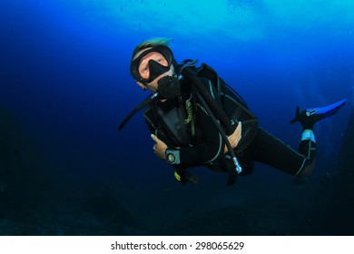 Female Scuba Diver exploring underwater reef