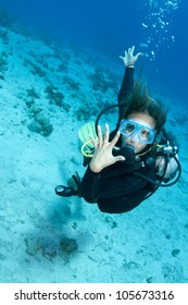 female scuba diver shows off her wedding ring