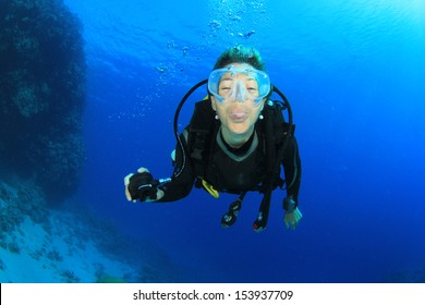Female Scuba Diver underwater having fun