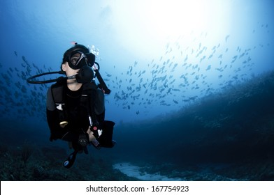 Female Scuba Diving in the Ocean