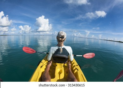 Female in sea Kayak from Behind.