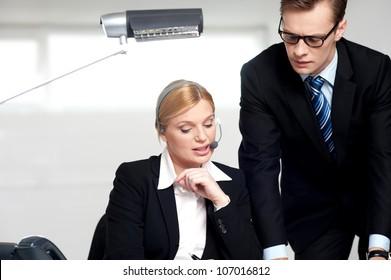 Female secretary explaining to boss in  the office