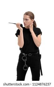 Female security guard using portable radio transmitter on white background