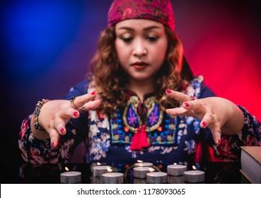 Female seer teller doing psychic reading predicting fate