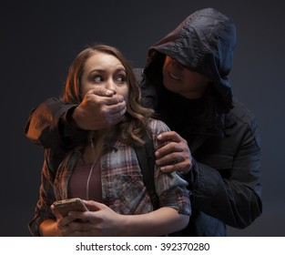 FEMALE SELF DEFENSE SERIES- Teenage Girl on a cell phone gets attacked by a stranger. He has his hand on her mouth and she's afraid.