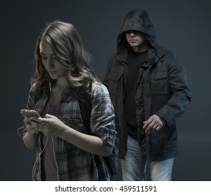 FEMALE SELF DEFENSE SERIES- Teenage Girl gets attacked by a stranger. He sees her texting and walking.Studio photo with filter applied.
