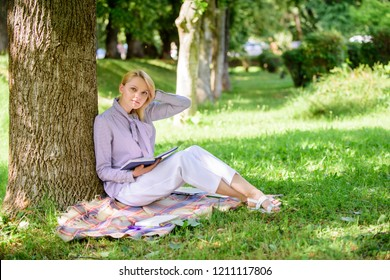Female self improvement. Self improvement book. Business lady find minute to read book improve her knowledge. Girl lean on tree while relax in park sit grass. Self improvement and education concept.
