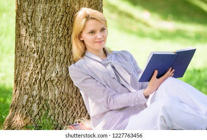Female self improvement. Girl lean on tree while relax in park sit grass. Self improvement book. Business lady find minute to read book improve her knowledge. Self improvement and education concept.