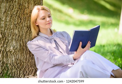 Female self improvement. Girl lean on tree while relax in park sit grass. Self improvement book. Self improvement and education concept. Business lady find minute to read book improve her knowledge.