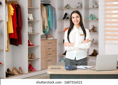 Female seller in modern clothes store