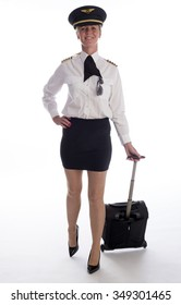Female senior airline officer in uniform and flight bag